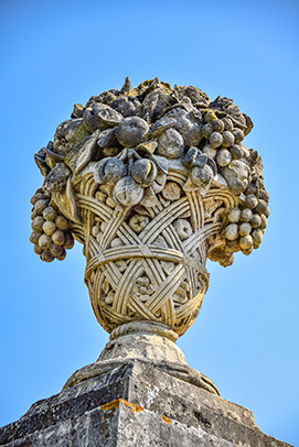 Stone basket full of fruits sculpted in the 17th century in the King's vegetable garden in Versailles